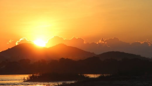 We began this article with sunrise at Phu Thok. So we'll finish with a sunset, taken from a longtail boat as the sun goes down over the hills of the Thai-Laos border and the River Mekong - a beautiful end to a day spent around Chiang Khan