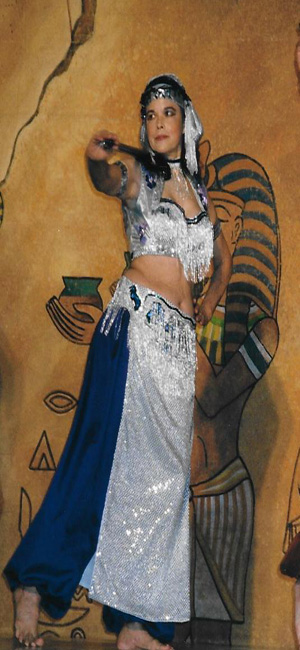 Dance instructor, Azizi, performing at a belly dancing seminar.