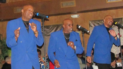 The Legendary Blue Notes perform steps in unison to their major hits.