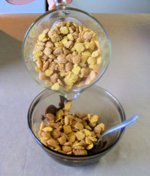 Pour cereal gradually into the melted chocolate and stir it gently