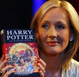 JK Rowling with her final Harry Potter Book - Credit: REUTERS
