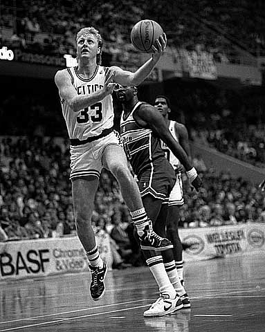 Boston Celtics legend, Larry Bird goes for a lay up.