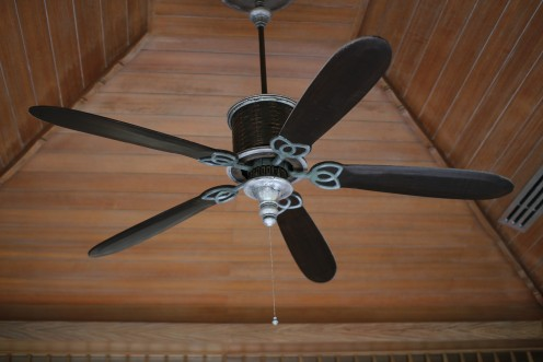 An electric ceiling fan keeps air moving and makes the room feel cooler.