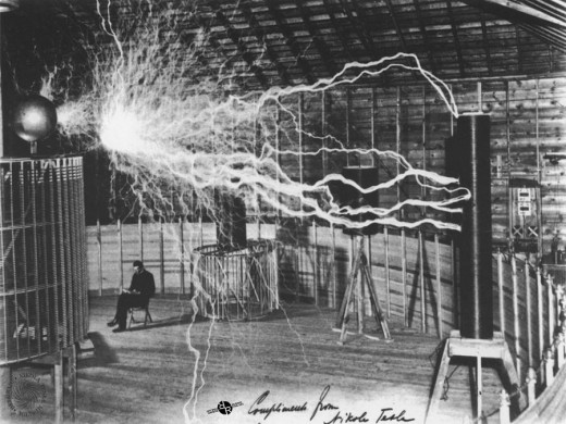 Nikola Tesla sitting in his experiment station.
