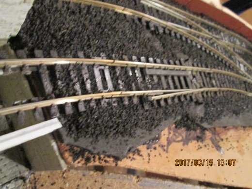 Ballasting's been added right up to the coal depot end wall.now the rails have been fixed in place across the cells.