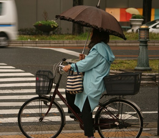 Cycling in the rain, Osaka, Japan.