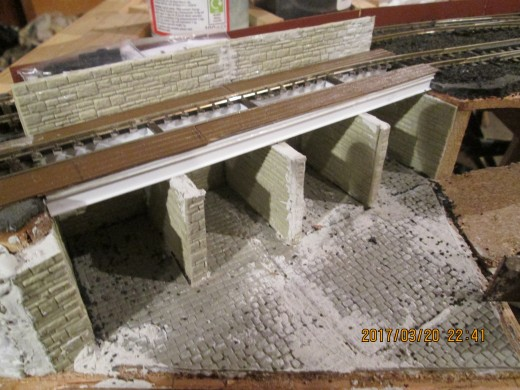 Supports for the timber decking on the coal depot have been added, the decking laid on to show how it will look before the guard rails have been mounted. Buffer stop to add at the right, past the last cell drop.