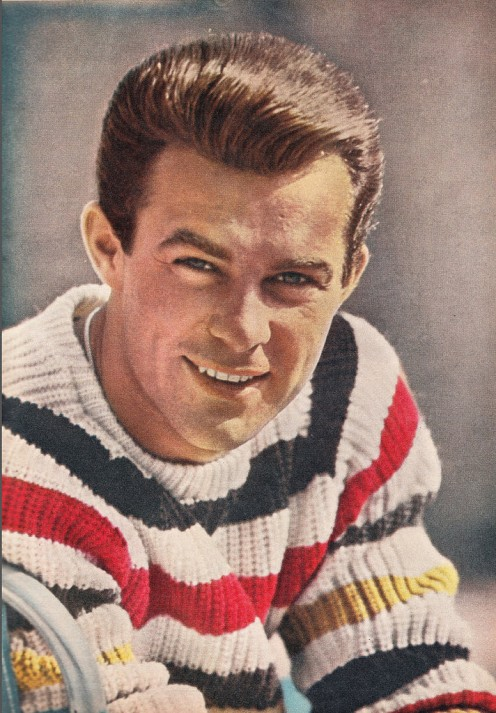 Robert Conrad, legendary Hollywood tough guy from CBS' Wild Wild West and  NBC' Black Sheep Squadron, is seen in this rare photo of him wearing a striped sweater.