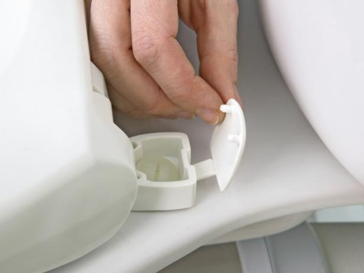 Ring is attached to ceramic pan with two long screws and plastic cap.