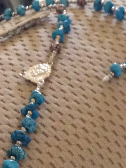 A sudden, unthinking Tug turns a Rosary into a string of beads.