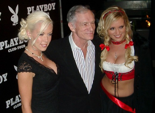 Hef with two of his girlfriends -- Kendra Wilkinson and Bridget Marquardt -- before he married model Crystal Harris in 2012.