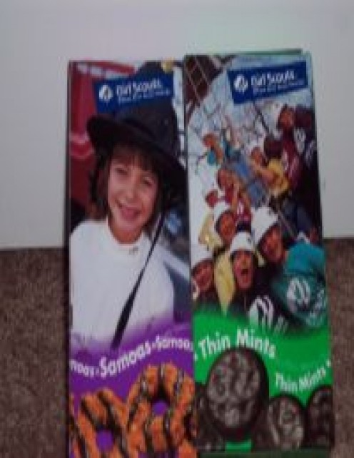 Boxes of popular Girl Scout cookies: Samoas, Thin Mints.