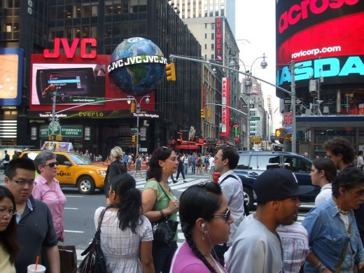 """Known as Longacre Square until 1904, when it was renamed, Times Square is located at the junction of Broadway and Seventh Avenue.  Its nicknames include """"The Crossroads of the World"""", and  """"The Center of the Universe""""."""