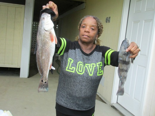My sister display the size of some of the fish we caught in the Outer Banks.