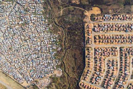 Although Apartheid was demolished In 1994 and   previous 'only-white' neighborhoods are no longer only white, the majority of Africans still live segregated in the townships that were established during Apartheid.