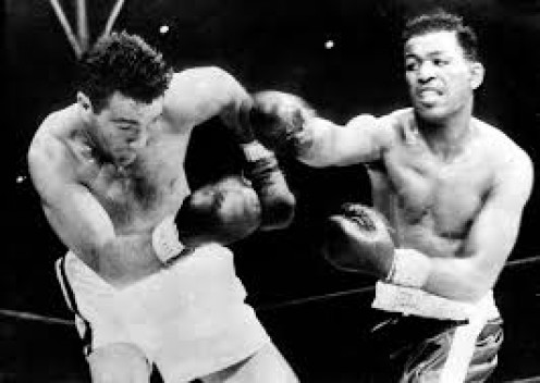 Joey Maxim beat Sugar Ray Robinson by 14th round knockout in defense of his light heavyweight (175 pounds) title fight.