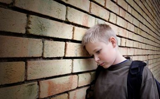 A deject kid on the street