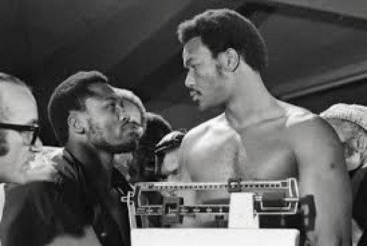 Joe Frazier looked small compared to George Foreman at the weigh in before the bout.