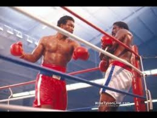Both boxers tasted the canvas several times before the heart and power of Big George ended matters.