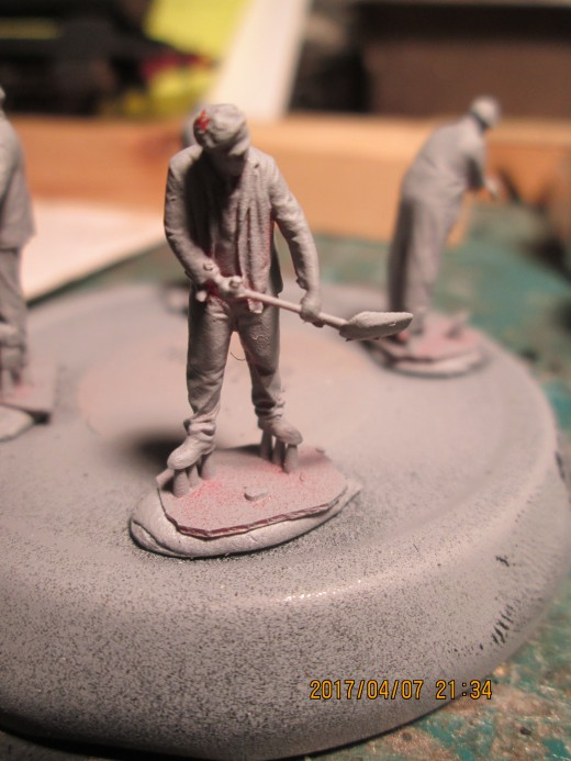 Primed and ready for detail painting - a 4mm Modelu railway figure that shows attention to detail in the way working clothes hang on - say - a locomotive fireman (stoker in the US?).