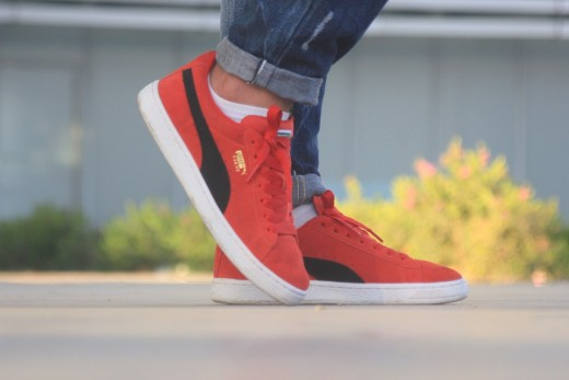 Red and black Puma suedes