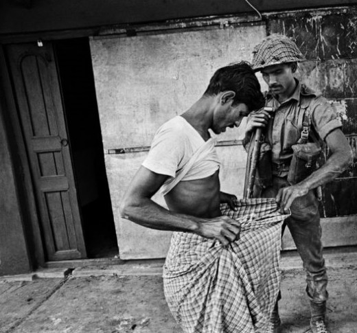 A Pakistan army officer inspecting a civilian for circumcision to ascertain his the Hindu/Muslim identity