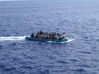 This small boat of refugees is going from Libya to Italy. They are lucky since the Sea is calm and the boat seems working well, so, they could be lucky to disembark on the coast of  Italy, with no help from the Italian Navy