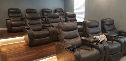 The finished product - 10 power reclining chairs in three rows with two platforms to create stadium style seating