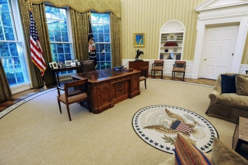 Obama's oval office shows a painting of the Statue of Liberty's flame.