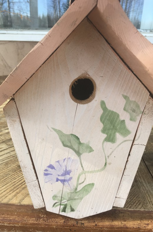 Front view of birdhouse with stencil painting