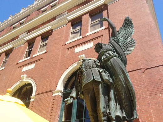 A different view of the sculpture which shows the angel's raised hand