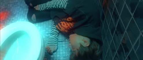 Jungkook collapsing on the floor.
