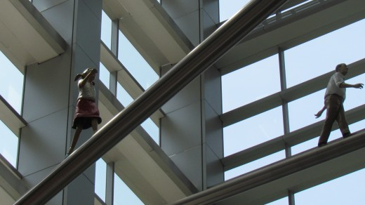 Another one of the climbing statues that are featured in the ceiling of the Comcast Center.