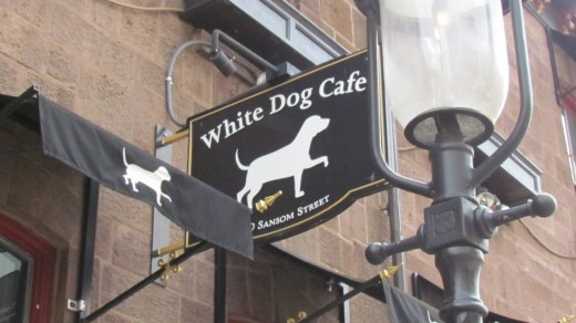 "The sign outside of ""White Dog Café"" located at 3420 Samson St., Philadelphia, Pa."