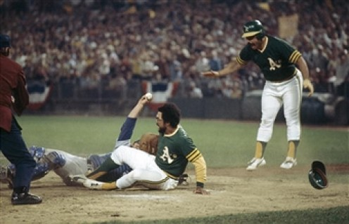Game 4 - Reggie Jackson just beats Yeager's tag as Sal Bando jumps out of the way.