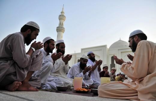 Muslims in worship in Saudi Arabia with Duas to Allah.