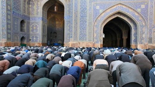 Muslims worshiping through prayer to Allah.
