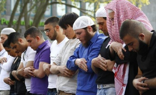 Muslims in Germany praying together.