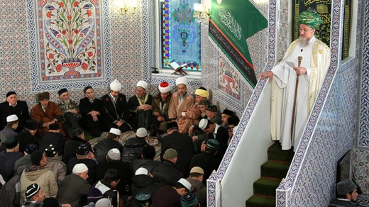 Muslims praying in a mosque in Russia.