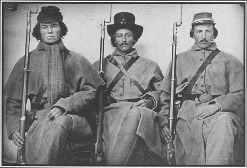 These civil war soldiers are sitting up perfectly straight with their legs crossed. How could they be sitting like this if they were dead?