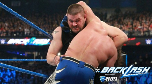 Kevin Owens about to suplex AJ Styles. Image: WWE