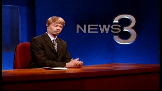 Chuck Taylor of News 3, a recurring news reporter throughout Season 1 played by Dave Chappelle. Image copyright of Comedy Partners.