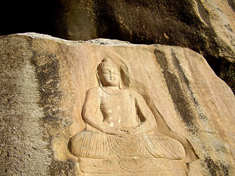 Engraving of Buddha that escaped the terrorism of Talibans.