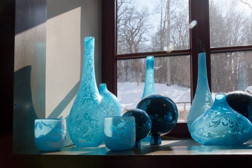 A selection of blue glass flower vases.