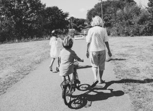 Adults can play a role of support to help kids learn how to ride a bicycle and be safe as well.