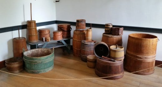 Besides making barrels, a cooper might make buckets and wooden churns.