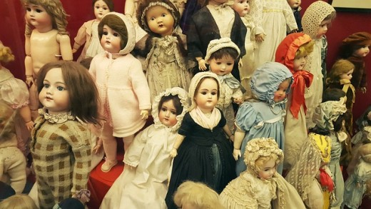 A collection of vintage dolls gathered in one setting.