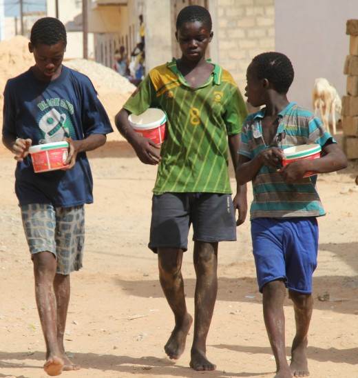 Talibé children with begging buckets