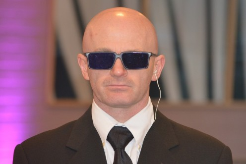 I think that baldness helps this bodyguard appear intimidating.