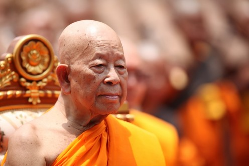 This is a Buddhist with his traditional bald head.